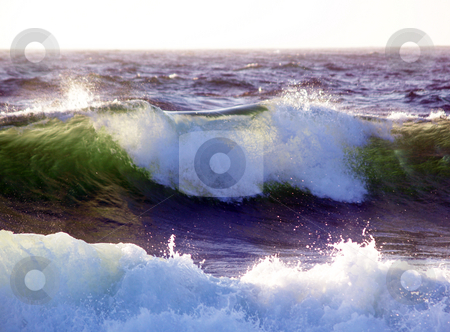 Wave breaking with sunlight coming through from behind stock photo, Waves starting to break backlit by sunlight by Jeff Cleveland