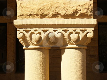Architectural detail of stone columns carving and texture stock photo, Two column supports with detail showing carvings and texture by Jeff Cleveland