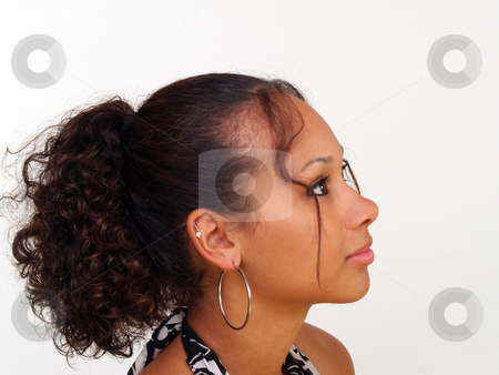 Woman profile stock photo, Pretty young black girl in profile portrait by Jeff Cleveland