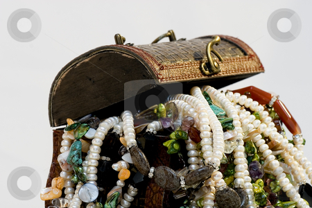 Chest full of jewelry treasures stock photo, Chest full of jewelry treasures by Fesus Robert