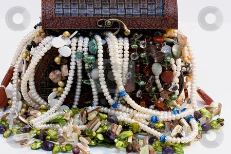 Chest full of jewelry treasures stock photo, Chest full of jewelry treasures by Fesus Robert