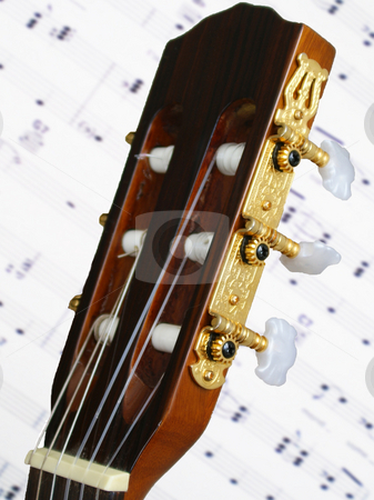 Acoustic guitar stock photo, Closeup of an acoustic guitar and tuners by Sam Sapp