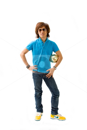 Sporty Asian guy stock photo, Sporty Asian guy in blue t-shirt, jeans and yellow Nike sneakers holding golden ball, isolated by Paul Hakimata