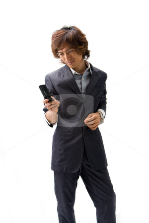 Asian business man and phone stock photo, Young Asian business man with mobile phone texting, isolated by Paul Hakimata