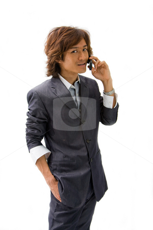 Asian business man and phone stock photo, Young Asian business man with mobile phone calling, isolated by Paul Hakimata