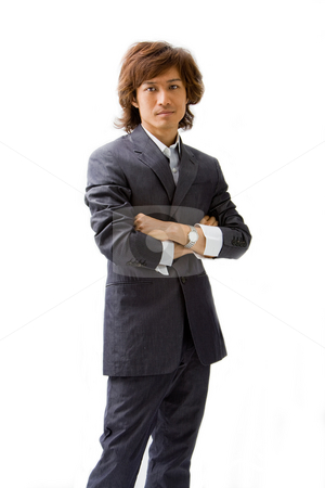 Young Asian business man stock photo, Young Asian business man dressed in a gray pinstripe suit with arms crossed, isolated by Paul Hakimata