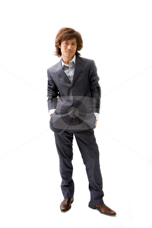 Young Asian business man stock photo, Young Asian business man dressed in a gray pinstripe suit with hands in pockets, isolated by Paul Hakimata