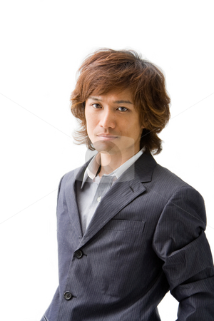 Young Asian business man stock photo, Relaxed Young Asian business man, isolated by Paul Hakimata