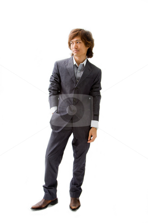 Young Asian business man stock photo, Young Asian business man dressed in a gray pinstripe suit with hand in pocket, isolated by Paul Hakimata