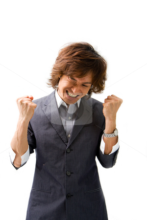 Business deal celebration stock photo, Young Asian business man celebrating a good deal, isolated by Paul Hakimata