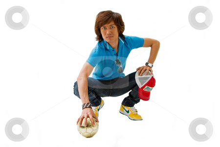 Handsome Asian guy stock photo, Handsome Asian man standing wearing casual clothes crouching, isolated by Paul Hakimata