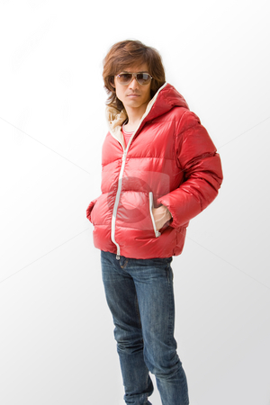 Cool Asian guy in red coat stock photo, Cool Asian guy wearing a red winter coat and sunglasses, isolated by Paul Hakimata