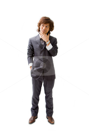 Young Asian business man stock photo, Young Asian business man dressed in a gray pinstripe suit with one hand in pocket and other on chin thinking, isolated by Paul Hakimata