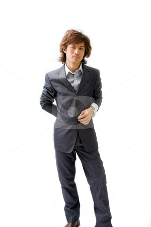 Young Asian business man stock photo, Young Asian business man dressed in a gray pinstripe suit with hand on back and button, isolated by Paul Hakimata