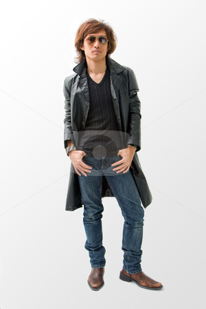 Cool Asian guy stock photo, Cool Asian guy wearing sunglasses and leather coat, isolated by Paul Hakimata