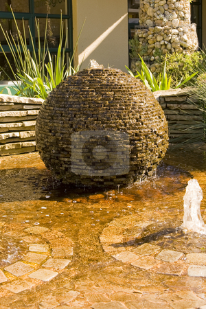 Beautiful water feature stock photo, A beautiful water feature in a public garden. by Nicolaas Traut