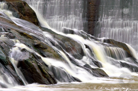 Waterfall stock photo, Water flowing over natural rock formations to form a waterfall. by Robert Byron