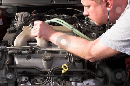 Auto Mechanic stock photo, An auto mechanic diagnosing a problem on an automobile. by Robert Byron