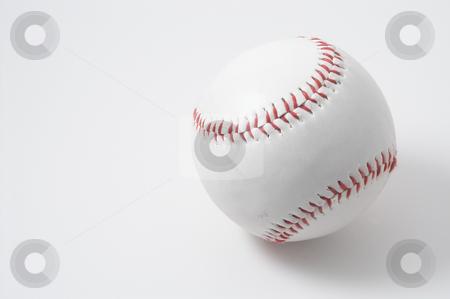 Baseball stock photo, A lone baseball with bright red stitching. by Robert Byron