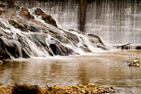 Waterfall stock photo, A stream pouring over a formation of rocks. by Robert Byron
