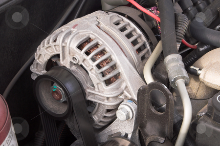 Alternator stock photo, The power plant or alternator of an automobile. by Robert Byron