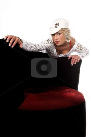 Seductive Blond stock photo, Head shot of a pretty blonde with short hair in a mesh top and white cap leaning over a chair and licking her lips by Robert Deal