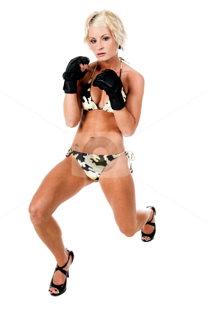Female MMA Fighter stock photo, Sexy blond mixed martial arts fighter in a camo bikini and MMA style gloves.  Full body by Robert Deal