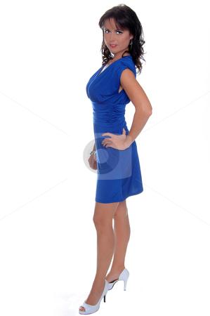 Blue Dress stock photo, Beautiful brunette in a sleek blue cocktail dress by Robert Deal