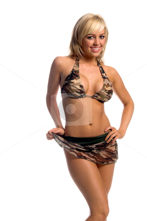 Camo Bikini Skirt stock photo, Sexy blond swimwear model in a brown and green camouflage bikini with a matching net skirt. Left hand on her hip and right hand lifting the corner of the skirt by Robert Deal