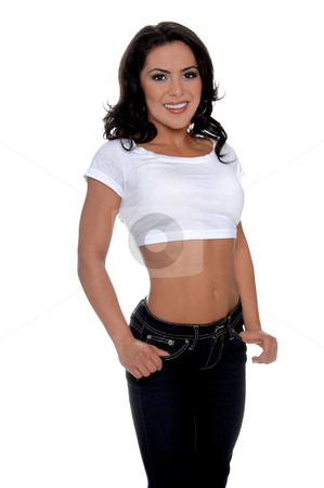 Latina woman in white top stock photo, Young female personal fitness trainer in designer jeans and a half t-shirt with her thumbs hooked in her pockets by Robert Deal