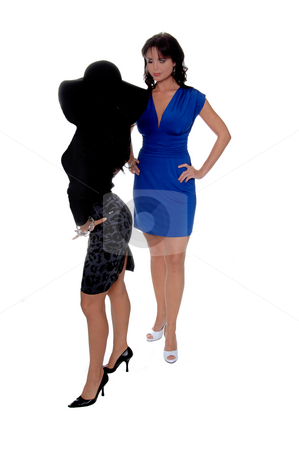 Feminine Attitude stock photo, Two women square off in postures that suggest attitude by Robert Deal