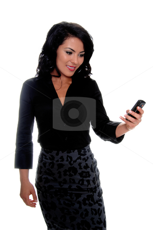 Mexican Woman Text Messaging stock photo, Beautiful young latina business woman sending a text message on a cell phone by Robert Deal