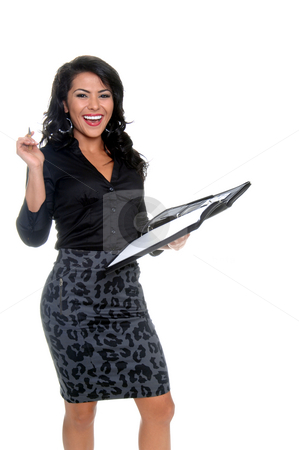 Business Woman stock photo, Beautiful young latina businesswoman  with a pen and a notebook laughing out loud by Robert Deal