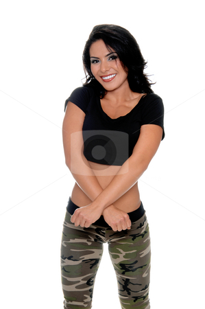 Female Fitness Beauty stock photo, Smiling young latin fitness model crosses her arms coyishly. Dressed in a black t-shirt and camo pattern pants by Robert Deal