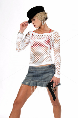 Fashion Diva Gangster stock photo, Sexy OC blonde fashion diva in a denim skirt, net top and red bra with a 45 caliber handgun at her side.   isolated over white. by Robert Deal