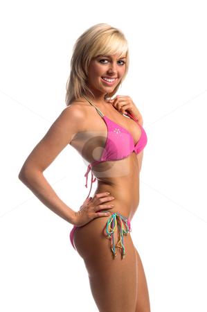 Rhinestone Bikini Blonde stock photo, Sexy blond swimwear model in a a deep pink rhinestone embellished bikini Right profile with hands on hips by Robert Deal