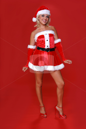 Mrs. Santa  stock photo, Sexy blond Mrs Santa in a red velvet suit by Robert Deal