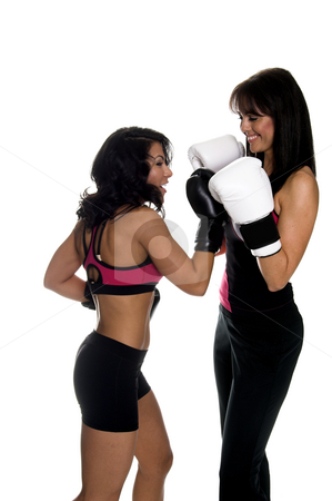Girls Boxing stock photo, Two young women sparring and one connects with an uppercut.  Some motion blur on the punching fighter by Robert Deal