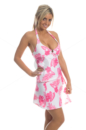 Pink Hibiscus tankini Blonde stock photo, Sexy blond swimwear model in a  bold pink Hibiscus flower print tankini top and matching skirt by Robert Deal