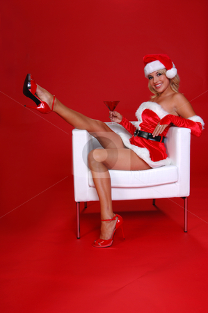 Christmas Martini stock photo, After a long days work Santa's sexy helper throws her feet up and relaxes with a fresh Christmas Martini. by Robert Deal