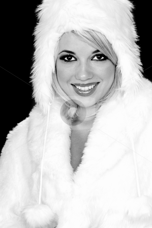 Fuzzy Snow Bunny stock photo, Sexy blond snow bunny in a white furry coat and hat by Robert Deal