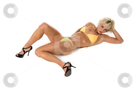 Blond in Yellow Bikini stock photo, Sexy blond swim wear model laying on the floor in a yellow bikini by Robert Deal