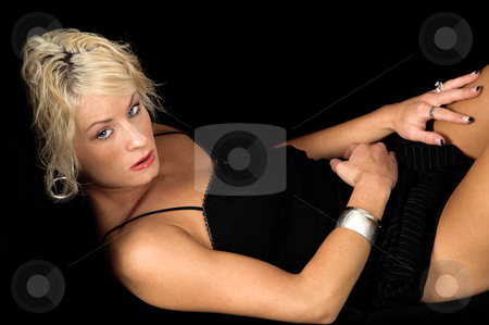 Pretty Blond Laying On Couch stock photo, Pretty blonde fashion model with short blond hair laying on a black  couch by Robert Deal