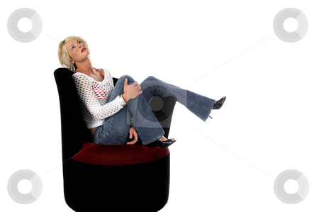 Blond In Velvet Chair stock photo, Fullbody shot of a pretty blonde with short hair and a nice smile sitting in a velvet wing backed chair by Robert Deal