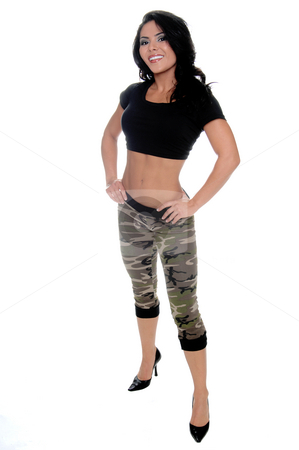 Full body hispanic woman stock photo, Sexy young latin fitness model standing with her hands on her hips in a black t-shirt and camo pattern pants by Robert Deal