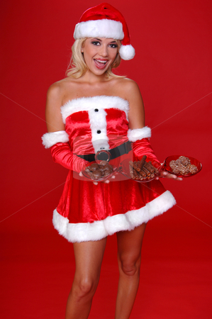 Christmas Chocolates stock photo, Sexy Mrs Santa carrying a tray of Christmas Chocolates by Robert Deal