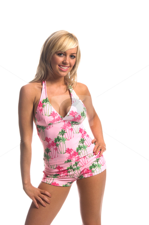 Island Tankini Blonde stock photo, Sexy blond swimwear model in pink island print tankini hips kicked to the left with left hand at the hip by Robert Deal