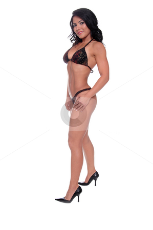 Bikini Fitness Model stock photo, Beautiful young Latina compition fitness model in a multicolored sequined figure compition bikini by Robert Deal