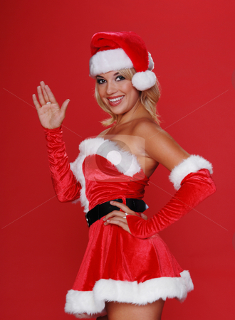 Santa's Christmas Helper stock photo, Santa's sexy helper offeres a friendly wave and a smile by Robert Deal