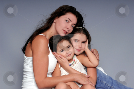 We are Family stock photo, A mother and her two young daughters in a formal portrait by Robert Deal